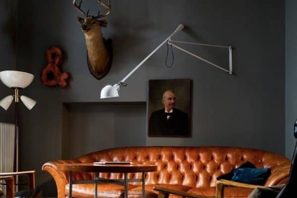 Create a gentleman's lounge feel with dark walls, leather sofas and some classic objet d'art. Its fun and eclectic. Love it.